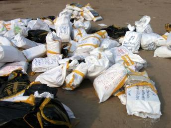 Packets of ballot papers lying on the floor at the Fikin International compilation centre in Kinshasa